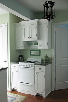 tiny kitchen redo; SUPER CUTE. 40's cottage styling. very sweet.