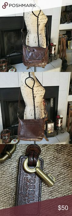FOSSIL CROSSBODY BAG All leather , good condition, brass hardware, no rips, tears or stains, only defect shown on last two pictures , does not affect function of strap Fossil Bags