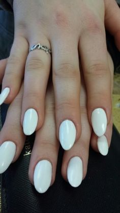 White nails with oval tips