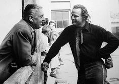 Jacques Tati and Marlon Brando I wonder what they're talking about--I've never seen a photo where Brando is smiling so much.