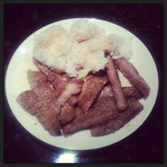 Soy sauce, steak, and steamed rice.