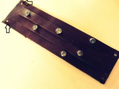 Leather Work - Bracelet in hole-punched leather.