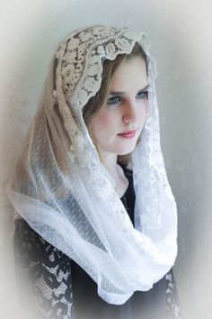 What is an Infinity veil?. It is a continous loop, simply place it over the head with gathered seam in front, and lift up to veil. It stays in place, and can't slip off. Our veils are soft and comfortable, and won't distract you by slipping off.