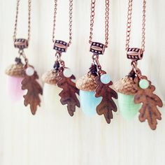Wonderful one of a kind handmade lampwork glass overhead pendants in the form of acorns. Made of pastel colored handmade lampwork glass beads