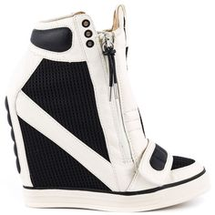 Put a pow in your step with the Nala! L.A.M.B. delivers a new spin on the sneaker wedge with a black and white meshed leather upper. Adding height is a 4 1/2 inch wedge and 1 inch rubber bottom.