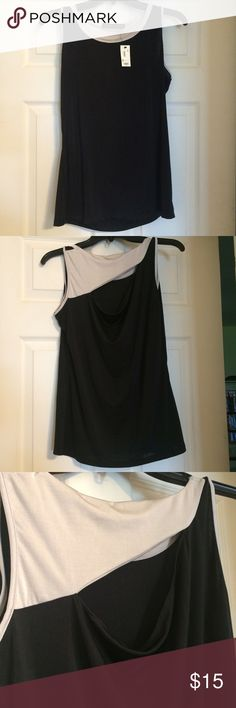 NWT Limited stretchy black and cream tank top Brand new super cute tank top. Unique design in back. The Limited Tops Tank Tops