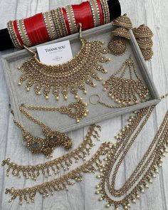 Sharing a photo of our beautiful antique gold RANI bridal set with layered mala, jhoomer pasa, nose chain, bridal Choora bangles, kaleerein… Pakistani Bridal Jewelry, Indian Bridal Jewelry Sets, Indian Jewelry Earrings, Jewelry Design Earrings, Wedding Jewelry Sets, Jewelry Accessories, Indian Necklace, India Jewelry, Ear Jewelry