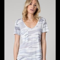 """Camo White Pocket Tee """"Favorite tee"""" is an understatement. Complete with a curved v-neckline, a relaxed raw edge pocket, and finished in our signature burnout treatment, this tee is one you'll want to stock up on in every color.  The signature burnout fabric will change with time. Ensure to hand wash or machine wash cold, gentle cycle, lay flat to dry (dryer will harm the fabric), and *wash before wearing. Fit Relaxed fit. PLEASE DO NOT PURCHASE THIS LISTING REQUEST A SIZE AND WE WILL CREATE…"""