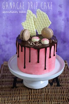 My first ganache drip cake inspired by the amazing Katherine Sabbath. Chocolate cake filled and covered with vanilla buttercream, drizzled with chocolate ganache and topped with white chocolate bubblewrap, nutella chocolate macarons and pink graffiti chocolates. A happy birthday cake :)   www.serendipitybakes.co.uk
