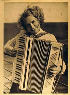 Vintage Postcard:  So happy playing her Hohner!