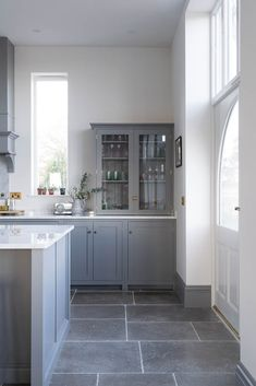 grey flooring A local customer teamed our Dove Grey Tumbled Limestone with a gorgeous Lead kitchen from deVOL Kitchens Gray Kitchen Backsplash, Grey Kitchen Floor, Refacing Kitchen Cabinets, Grey Floor Tiles, Grey Flooring, Kitchen Flooring, White Cabinets, Flooring Ideas, Backsplash Design