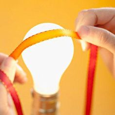 Ribbon Iron - Get wrinkles out of a ribbon by pressing it on a lightbulb!