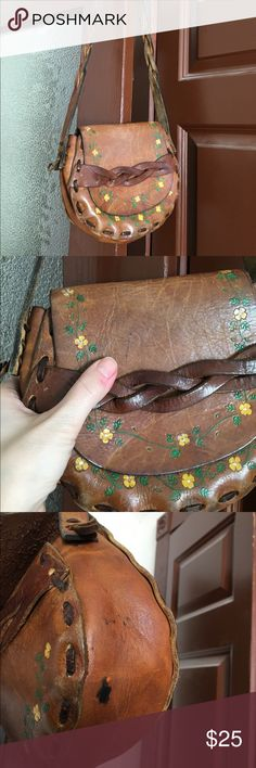 Penny Lane, hippie festival purse Adorable vintage hippie festival purse. Tooled leather partially braided shoulder strap.. Has a few small marks. Please see photos. Lots like a scratch, red ink and ink at the bottom of the bag. Perfectly worn in and pre-loved. For your inner flower child..be festival or beach ready!🌼🌻🌼 American Vintage Bags Shoulder Bags