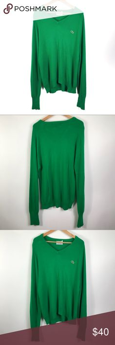 "Lacoste Men's Green V-neck Knit Sweater XL Lacoste Men's Green V-neck Knit Sweater Size XL  In good condition; Right arm hem has pulls but can be folded when worn - see last photo  Izod x Lacoste brand colab design  Flat Measurements  Shoulder to shoulder 22"" Armpit to armpit 23"" Length from shoulder to hem 32""  Materials  Tag was removed  Item Number 56UTCS001 Lacoste Sweaters V-Neck"