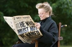 "McGonagall chillin' while reading a Daily Prophet . | 23 Images That Will Change The Way You Look At ""Harry Potter"" - Just want to keep this picture for forever"