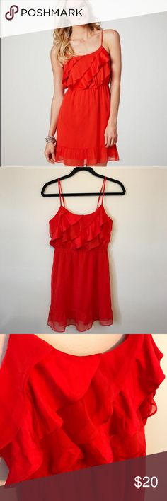 Red dress Red ruffle dress. MEASUREMENTS (all taken lying flat) Bust: 15 inches (adjustable due to tie at back) Waist: 12 inches Length: 33 inches American Eagle Outfitters Dresses