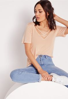 Update your wardrobe staples with this chic  V back t-shirt. It's loose fit, soft jersey fabric and V neck style makes this a winning piece to create an effortless, laid back style. Keep it simple and team with your fave skinnies and skat...