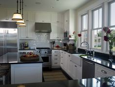 Design Chic....love the expanse of windows over sink and counter area