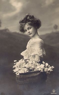 Vintage Images... beautiful little girl with a basket of flowers