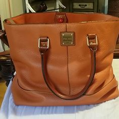 Beautiful Dooney and bourke pebbled leather tote Adorable, used very little, 14in.wide by 11in.high Bags Totes