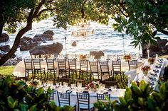 Colorful Wedding Table Decor by Bliss Wedding Design - oceanfront Maui Wedding - chandelier and florals
