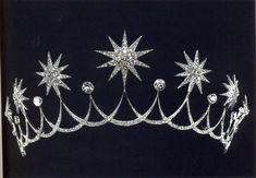 A diamond tiara by Chaumet, 1912. Designed as a series of alternating diamond stars, and circular diamonds, linked by diamond swags.