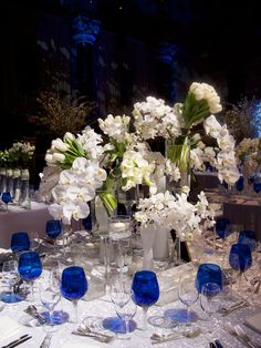 All White centerpieces with colbolt blue accents