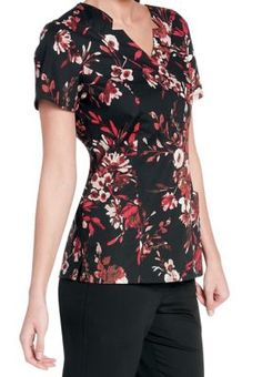 <p>The gorgeous floral print of the Rhapsody scrub top makes it stand out from the rest!  This beautiful offering from the popular Landau Smart Stretch collection is made with luxurious stretch fabric that is a pleasure to wear throughout your workday.  Flattering princess seams will enhance your figure and four deep lower pockets give you plenty of room to carry your favorite accessories.  Banded trim, accent piping, and side slits round out the look of this awesome top!</p> <ul…