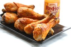The best buffalo chicken drumsticks, these have a secret ingredient to make them truly crispy.