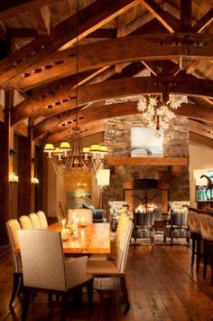 Gorgeous dining & great room in a Beautiful Rustic Mountain Home with a   Moravian star chandelier
