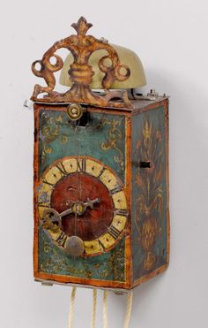 Iron Clock, with pendulum, probably Swiss, late Renaissance. 17th c. enclosed case, painted with tendrils and vases.
