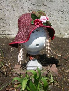 bowling ball garden art ~~or keeper of the garden. ;-)  I would glue pennies to her face for color, etc.