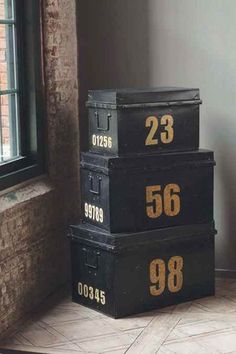 Vintage metal stacking trunks. A stylish way to place storage in a room. Put a lamp and a small retro alarm at the top and the look would be complete.