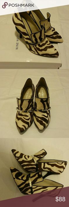 Women shoes Brown and white animal print Nine west Bettergo pumps, with black heel, cow leather/leather upper. Nine West Shoes Heels