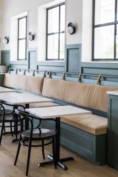 restaurant seating Banquet seating with leather back rest with straps and a rod + two toned green and white walls + modern lighting Banquette Seating Restaurant, Banquette Bench, Kitchen Banquette, Kitchen Seating, Dining Nook, Kitchen Nook, Dining Chairs, Wall Seating, Built In Seating