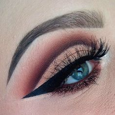 Instead of a beautifully buffed smoky eye, the goal of a cut crease is to create a starkly defined arc that...