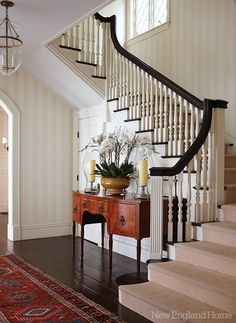 An heirloom sideboard and grand staircase helps to create an elegant entryway in this coastal home. Architecture by Robert Zarelli and interior design by Charlotte Barnes. Photography by Michael Partenio. Welcome Home Traditional Decor, Traditional House, New England Homes, New Homes, Style At Home, Foyer Staircase, Staircases, Entry Foyer, Staircase Architecture