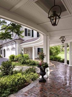 Breezeway designs should be functional and beautiful as they are a part of the architecture of your home. Tips to consider when designing a breezeway. Exterior Light Fixtures, Exterior Lighting, Outdoor Lighting, Style At Home, Brick Design, Exterior Design, Patio Design, House Columns, Brick Columns