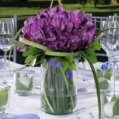 How pretty is this centerpiece with purple Peruvian lilies?