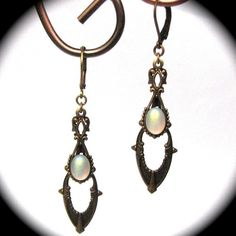 Exquisite Art Deco Style Drop Earrings in Brass with Iridescent Opal Glass Cabochons $24.00