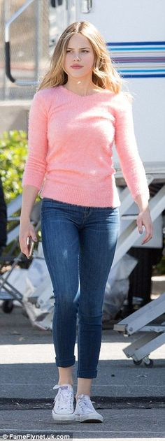 Pretty in pink! Joining Thorne on set was costar Halston Sage, 22, who wore a soft cashmere sweater with cuffed denim jeans and white Converse sneakers