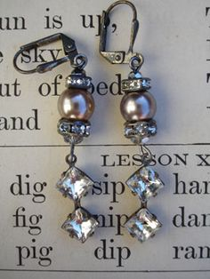 Double Diamond and Pearl Repurposed Dangle Earrings - From silverplate leverback earrings hangs 2 Swarovski crystal spacers - one round, one square; a gray glass pearl and a silvery crystal faceted bead. From the bottom is a vintage clear faceted glass dangle with two diamond shapes in one setting...