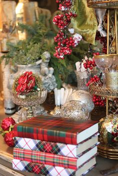 I love the idea of wrapping books with Christmas paper to be placed around the house and used for display--from the Romancing the Home blog - artan plaid Christmas