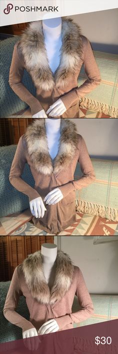 """The LOFT detachable """"fur"""" collar long cardigan. NEVER WORN -LOFT tan cardigan w/ placket covered buttons. Detachable fun """"fur"""" collar (cream with flecks of black) attached w/ hidden buttons. Wear it smoothed down or fluffed up for different looks. Super soft 54% cotton 40% rayon 6% wool sweater is 29 inches length. Sleeves are 26 inches length. Machine wash cold. Cute with leggings, & skirts. A true 3 season cardigan without the collar. ALSO have Black version in xs. Collar works on BOTH…"""