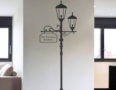 A classic London lamp post wall sticker with personalised sign. Great for hallways, living rooms and outdoors.