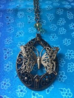 Butterfly necklace Bronze .20 inches long.$20.00 plus $5.00 shipping