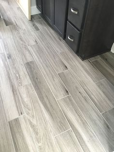 For the granny - Newly installed gray weathered wood plank tile flooring Plank Tile Flooring, Wood Plank Tile, Wood Tile Floors, Grey Flooring, Wood Planks, Bathroom Flooring, Kitchen Flooring, Flooring Ideas, Wood Look Tile Floor