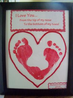 "Valentine's footprint heart ~ From our daughter to her Father on Valentines Day!  Typed up ""I love you from the tip of my nose, to the bottom of my toes"" on the computer in red.  Supplies needed for this project...Washable red paint for the footprints, card stock, string and a picture frame (this was 8x10).  Have fun and Happy Valentine's Day! ♥"