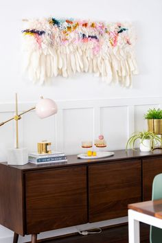 """""""Behind the table we went for a closed mid-century sideboard instead of open shelving so that a) we could hide all of our crap, and b) it would be tucked away from future crawling baby hands."""" Photo by Sugar and Cloth."""