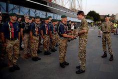 Prince Harry talks to Marine Tom Barker